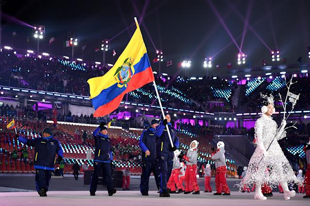 <p>Flag bearer of Ecuador Klaus Jungbluth Rodriguez and teammates enter the stadium during the Opening Ceremony of the PyeongChang 2018 Winter Olympic Games at PyeongChang Olympic Stadium on February 9, 2018 in Pyeongchang-gun, South Korea. (Photo by Matthias Hangst/Getty Images) </p>