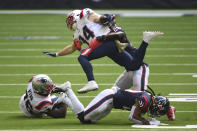 New England Patriots running back Rex Burkhead (34) is hit by Houston Texans strong safety Justin Reid (20) on a run during the second half of an NFL football game, Sunday, Nov. 22, 2020, in Houston. Burkhead was injured on the play. (AP Photo/Eric Christian Smith)