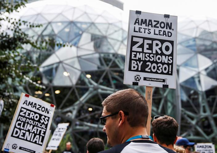An attendee holds a sign asking Amazon to reach zero emissions by 2030 outside the Amazon Spheres during a Climate Strike walkout and march in Seattle, Washington, U.S. September 20, 2019. (Photo: REUTERS/Lindsey Wasson)