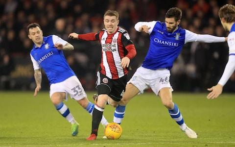 United's John Fleck and Sheffield Wednesday's Frederico Venancio (right) and Ross Wallace battle for the ball - Credit: Danny Lawson/PA Wire