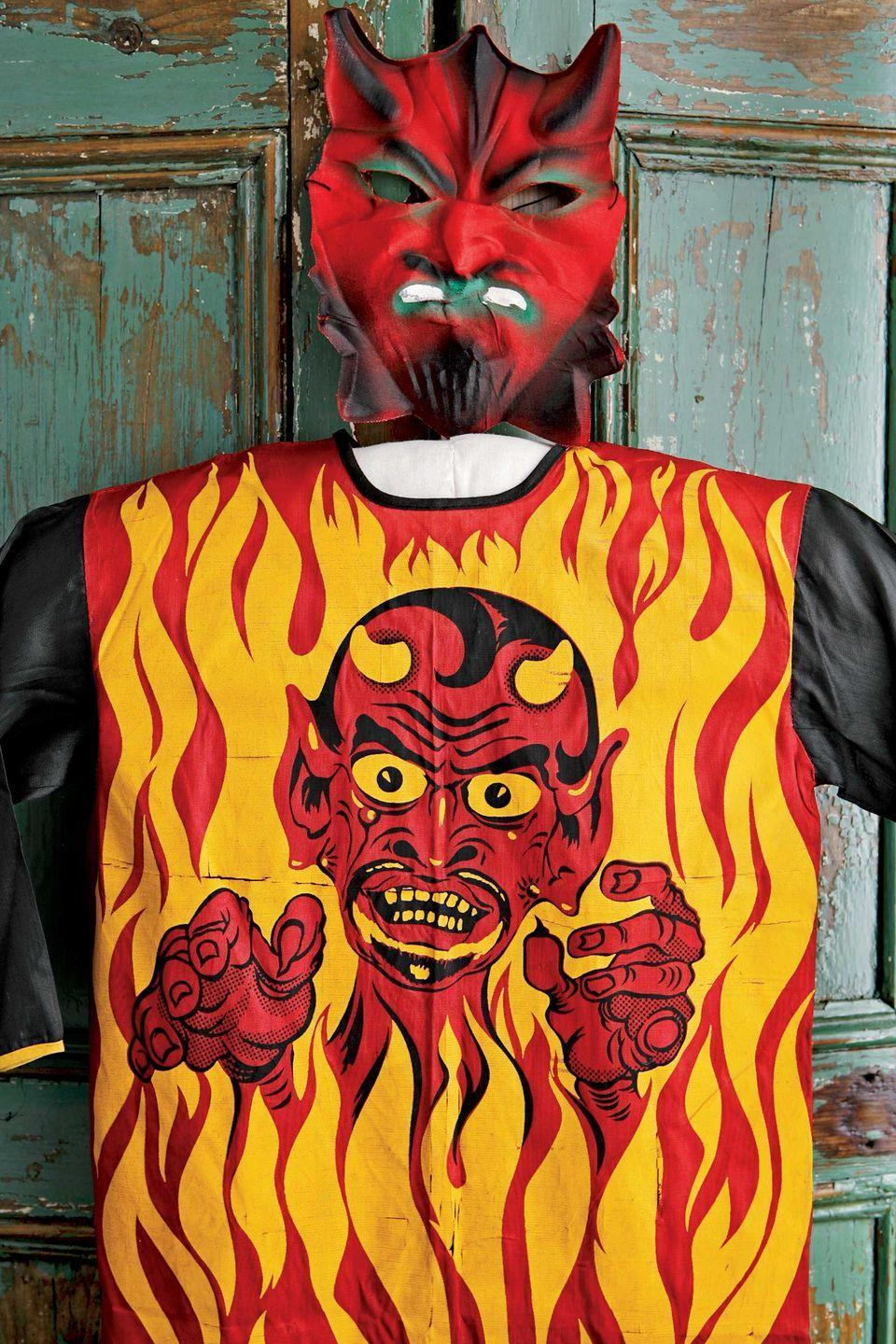 <p>This devil costume, complete with a folded cloth gauze mask, is from around 1952.</p>