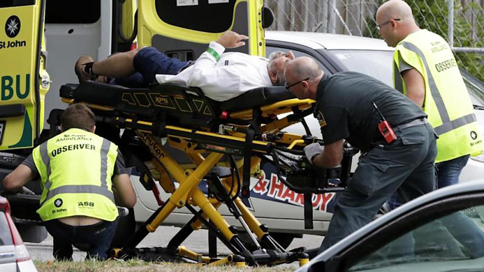 Emergency services personnel assist one of the victims. Image: AP