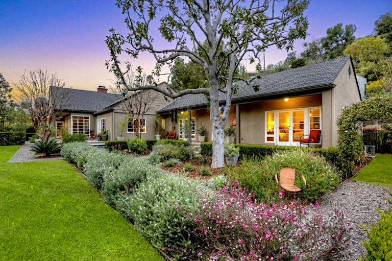 Listed for $3.6 million, the single-story home in Los Feliz was built in 1940 for Leonid Raab, a prolific orchestrator-composer from Hollywood's Golden Age. The 3,716-square-foot house was designed by architect Louis Selden, who designed numerous homes in the L.A. neighborhood. A series of gardens and outdoor living spaces surrounds the home, which sits on flat lot of nearly half an acre. Inside, the home features a vaulted-ceiling living room, a cozy den and an updated kitchen. There are four bedrooms and 3.5 bathrooms.