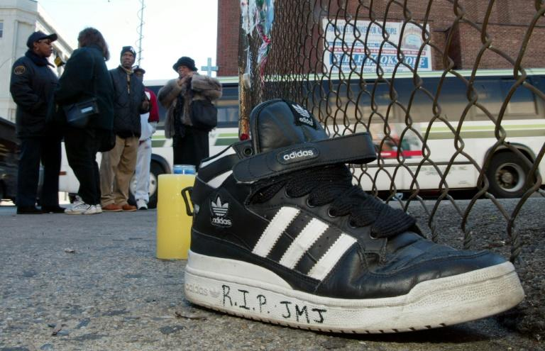 An Adidas sneaker bearing a mourner's message sits on the street outside the music studio in Queens where former Run-DMC member Jason Mizell, known as DJ Jam Master Jay, was shot dead