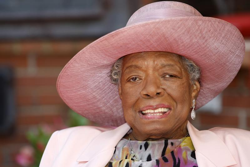 """FILE - In this May 20, 2010 file photo, poet Maya Angelou smiles as she greets guests at a garden party at her home in Winston-Salem, N.C.  In the midst of talking black history with Grammy-winning singer Alicia Keys, Angelou breaks out singing a hymn a cappella. She wants to show Keys, a New Yorker, what """"lining out,"""" call-and-response singing that is popular in Southern black churches, sounds like. That teaching moment is one of many during Angelou's third annual Black History Month program, """"Telling Our Stories,"""" airing on more than 175 public radio stations nationwide throughout the month. (AP Photo/Nell Redmond, file)"""