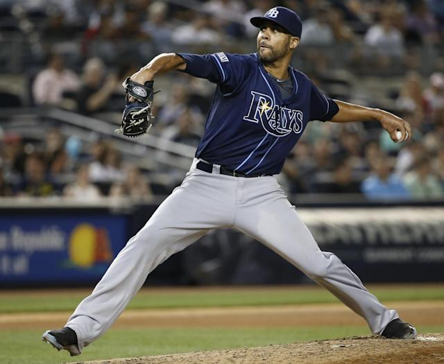 Tampa Bay Rays starting pitcher David Price delivers in the seventh inning of a baseball game against the New York Yankees at Yankee Stadium in New York, Tuesday, July 1, 2014. (AP Photo/Kathy Willens)