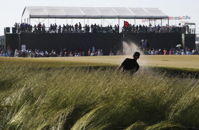 Tony Finau plays a shot from a bunker on the 13th hole during the final round of the U.S. Open Golf Championship, Sunday, June 17, 2018, in Southampton, N.Y. (AP Photo/Carolyn Kaster)
