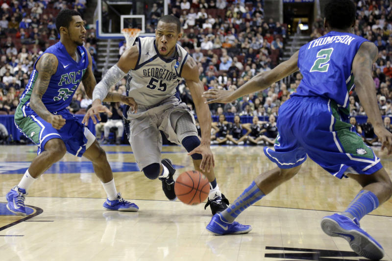 Georgetown's Jabril Trawick, center, dribbles between Florida Gulf Coast's Dajuan Graf, left, and Bernard Thompson during the first half of a second-round game of the NCAA college basketball tournament on Friday, March 22, 2013, in Philadelphia. (AP Photo/Matt Rourke)