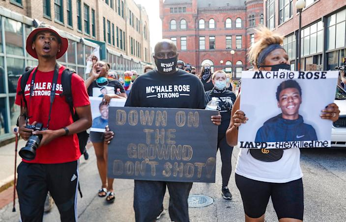 The father of McHale Rose, Myron Rose, middle, marches with McHale Rose aunt, Tommi Rose, left, in downtown Indianapolis, Wednesday, July 15, 2020. Protesters marched from the City County Building on Market Street to the Indianapolis Metropolitan Police Department the Downtown District on West Jackson Place calling for justice for Dreasjon Reed and McHale Rose.