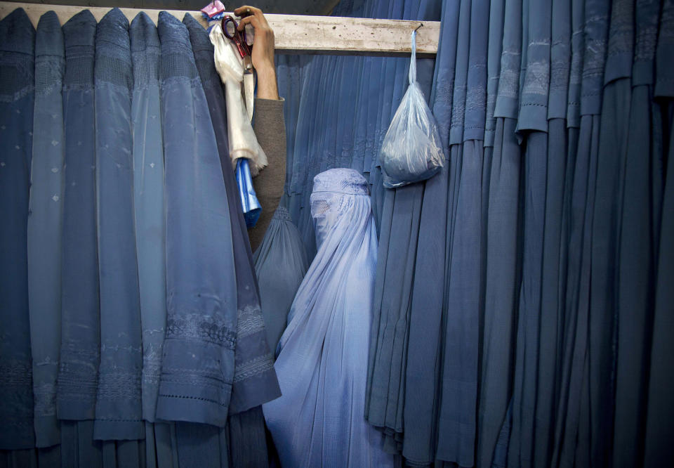 An Afghan woman waits in a changing room to try out a new Burqa, in a shop in the old city of Kabul, Afghanistan, Thursday, April 11, 2013. Before the Taliban took power in Afghanistan, the Burqa was infrequently worn in cities. While they were in power, the Taliban required the wearing of a Burqa in public. (AP Photo/Anja Niedringhaus)