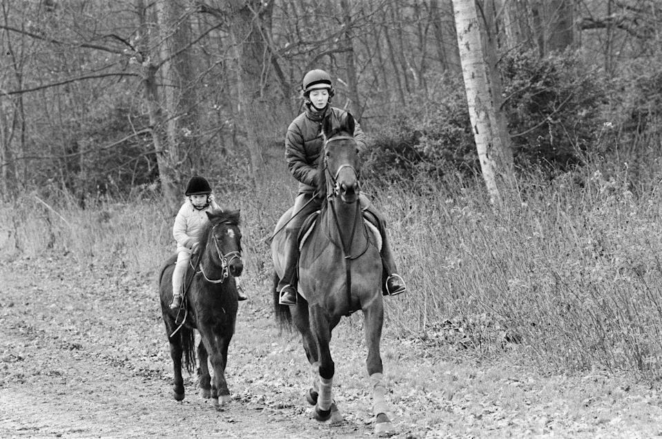 <p>Princess Anne's daughter, Zara Phillips, enjoys a riding lesson on the family's estate in Sandringham after the New Year holiday in 1987. The royal family travels to Sandringham every December and celebrates the Christmas holiday at St. Mary Magdalene Church. </p>