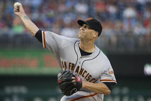 San Francisco Giants starting pitcher Tim Hudson delivers during the first inning of a baseball game against the Washington Nationals on Friday, Aug. 22, 2014, in Washington. (AP Photo/Evan Vucci)
