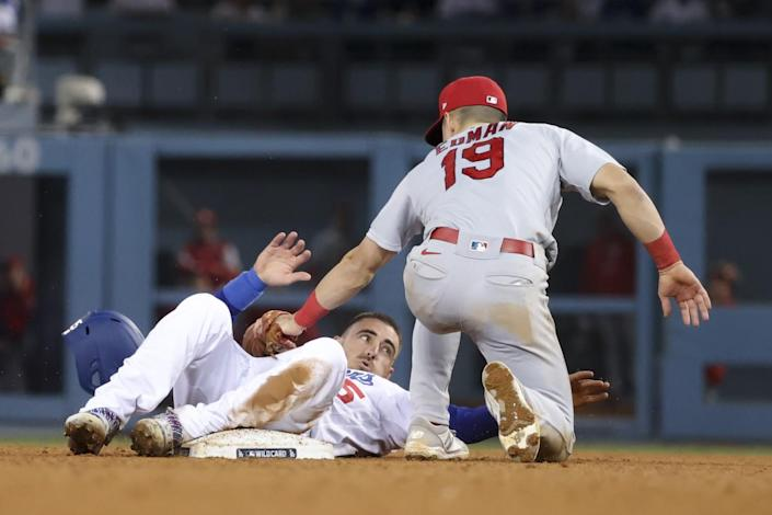 Los Angeles Dodgers' Cody Bellinger steals second base ahead of the tag by St. Louis Cardinals' Tommy Edman