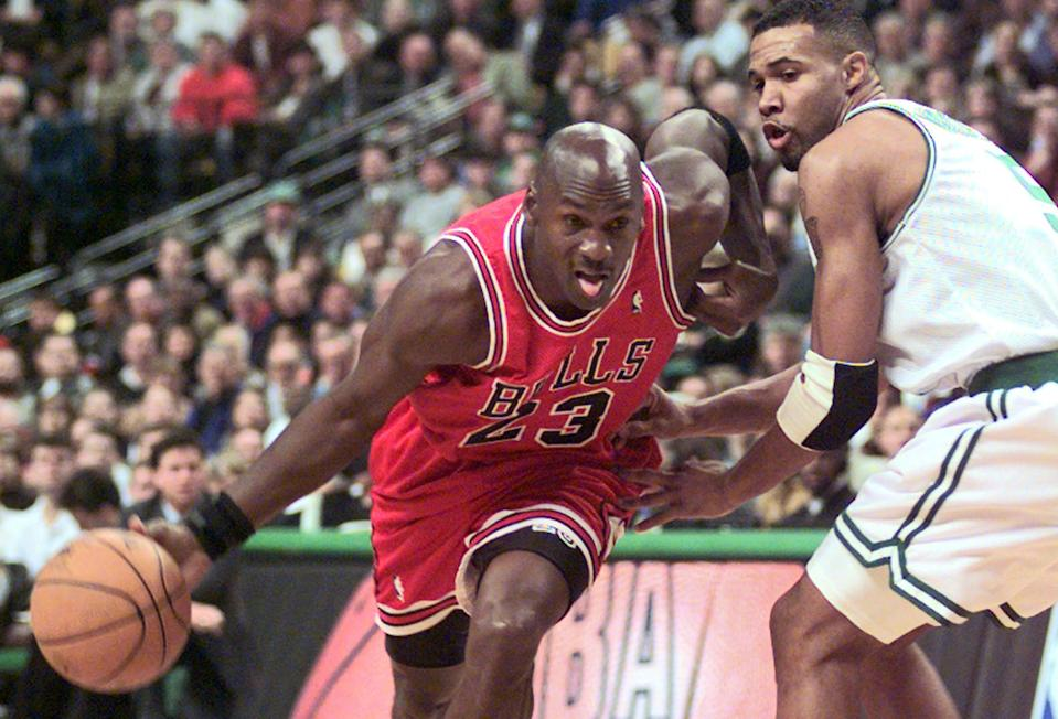 FILE - In this Oct. 31, 1997, file photo Chicago Bulls guard Michael Jordan (23) drives past Boston Celtics Ron Mercer (5) during an NBA basketball game in Boston.  A Bismarck, N.D., man who used to own McDonald's restaurants is about $10,000 richer after selling a 20-year-old container of McJordan barbecue sauce Monday, Oct. 15, 2012, to a buyer in Chicago. The sauce was used on McJordan Burgers, named for basketball icon in limited markets for a short time in the 1990s, when Jordan led the Chicago Bulls to six NBA championships. (AP Photo/Stephan Savoia, file)