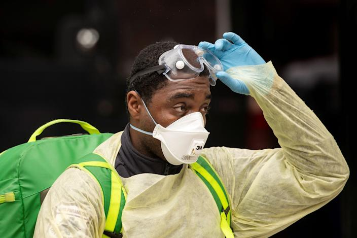 An Emergency Medical Technician (EMT) wearing personal protective equipment walks out of the Cobble Hill Health Center nursing home during the ongoing outbreak of the coronavirus disease (COVID-19) in the Brooklyn borough of New York, U.S., April 17, 2020.