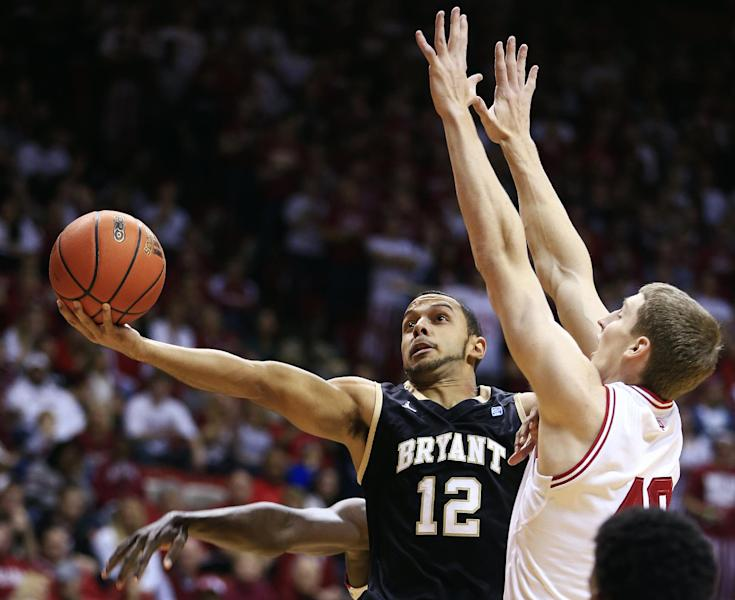 Bryant's Dyami Starks (12) shoots against Indiana's Cody Zeller during the first half of an NCAA college basketball game, Friday, Nov. 9, 2012, in Bloomington, Ind. (AP Photo/Darron Cummings)