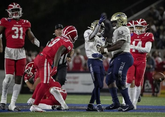 St. John Bosco running back Jabari Bates celebrates with teammate Edward Riley after gaining a first down against Mater Dei.