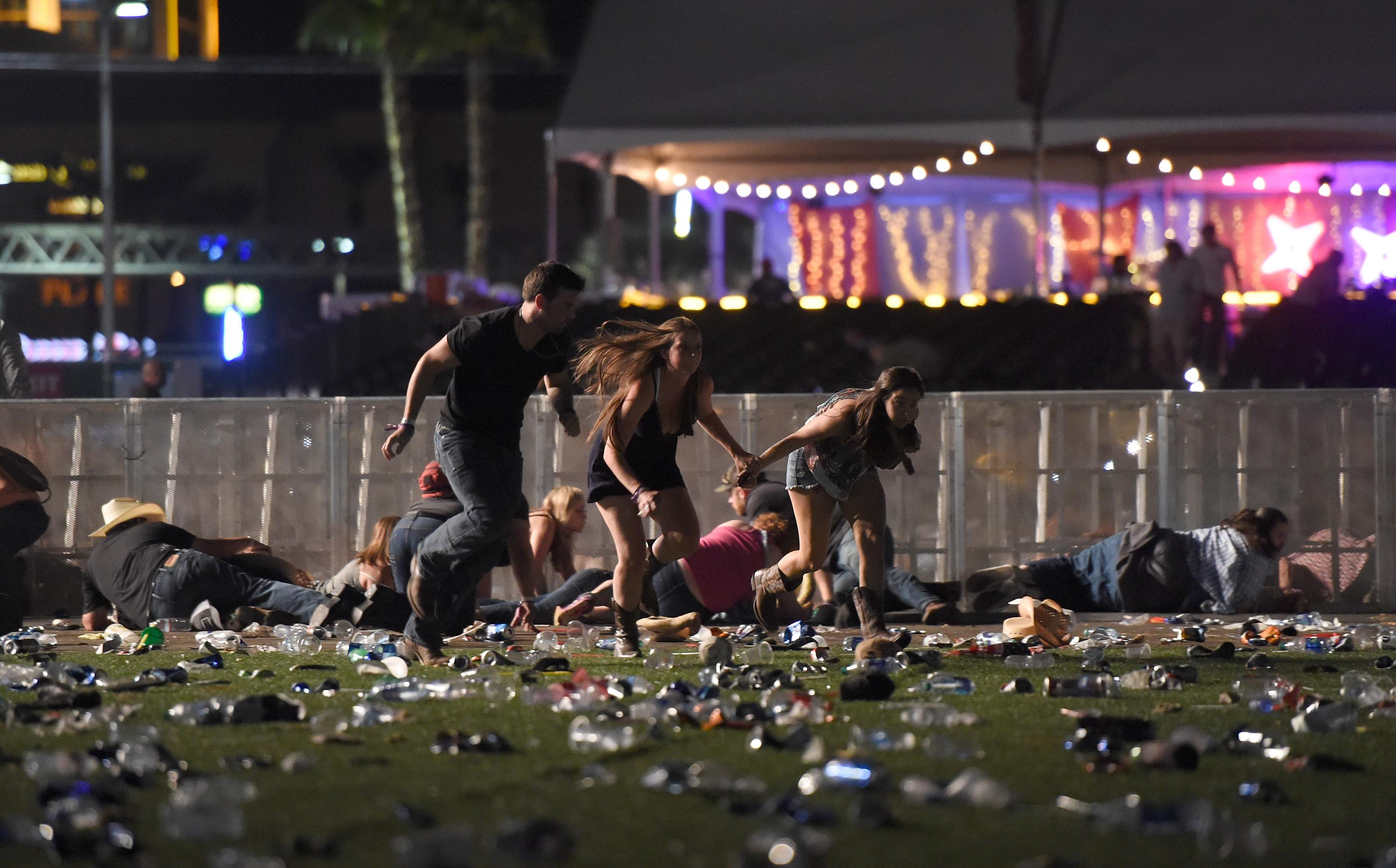 People lay on the on the ground while others fleed to avoid the shots (Picture: Getty)