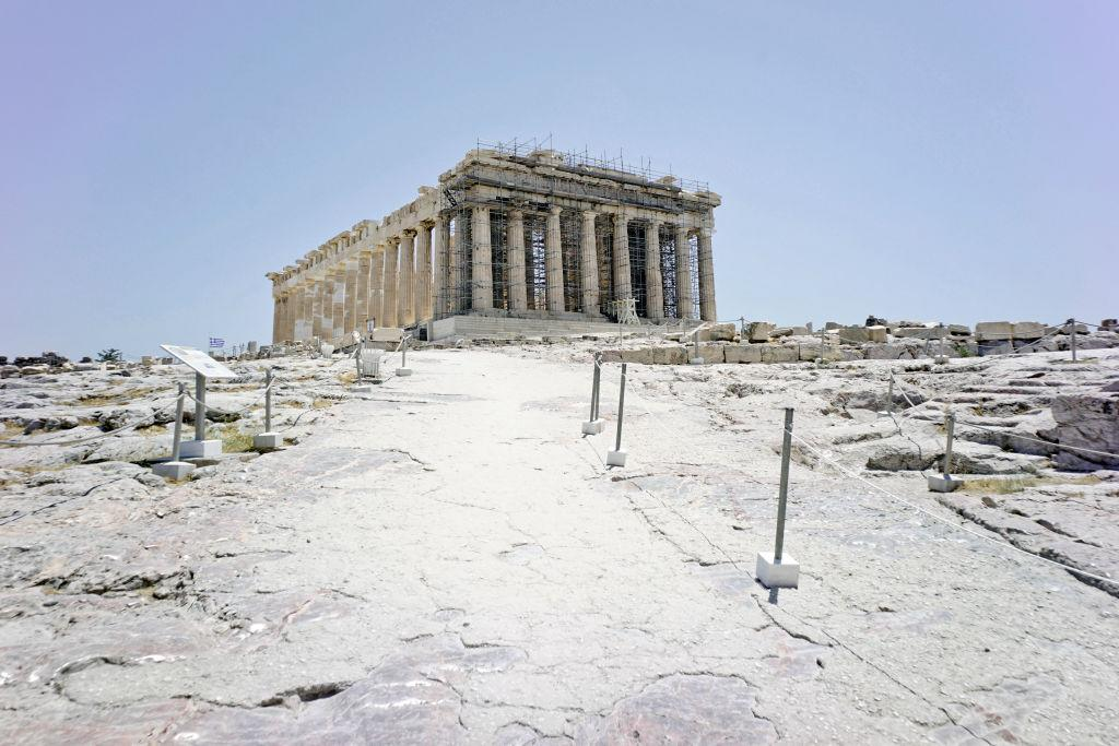 View of Parthenon Temple and empty archeological site of Acropolis on July 4 in Athens, Greece. Greece's Culture Ministry says that internationally famed Acropolis, will close during the hottest hours of the day due to a predicted heat wave. (Photo by Milos Bicanski/Getty Images)