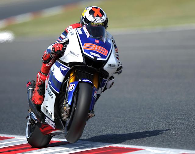 Yamaha Factory Racing's Spanish Jorge Lorenzo rides at the Catalunya racetrack in Montmelo, near Barcelona, on June 2, 2012, during the MotoGP third training session of the Catalunya Moto GP Grand Prix. AFP PHOTO/LLUIS GENELLUIS GENE/AFP/GettyImages