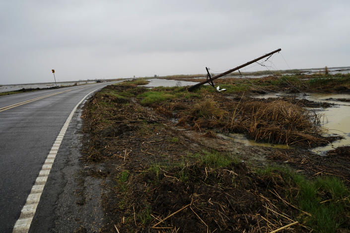 Downed power lines from Hurricane Laura line a desolate stretch of marsh on Hwy 27, leading to the town of Cameron, La., in advance of Hurricane Delta, in Cameron Parish, La., Thursday, Oct. 8, 2020. (AP Photo/Gerald Herbert)
