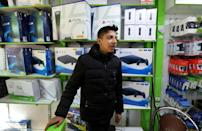 A vendor sells consoles at a shop in Tehran's central market. Neither Microsoft nor Sony are officially present in the Islamic republic due to Washington's punishing sanctions
