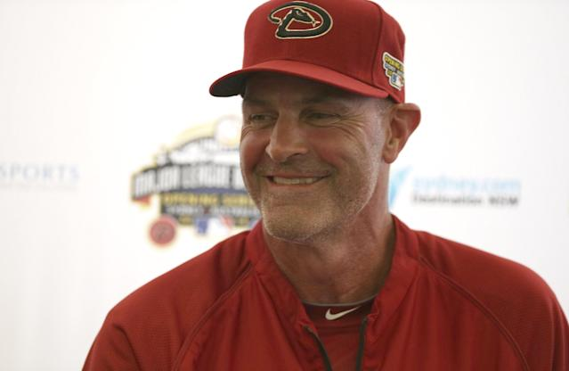 The Arizona Diamondbacks' manager Kirk Gibson laughs during a press conference at the Sydney Cricket Ground in Sydney, Tuesday, March 18, 2014. The MLB season-opening two-game series between the Los Angeles Dodgers and Arizona Diamondbacks in Sydney will be played this weekend. (AP Photo/Rick Rycroft)