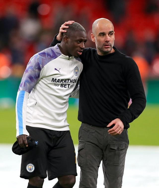 Pep Guardiola, right, defended the decision to select Benjamin Mendy last weekend