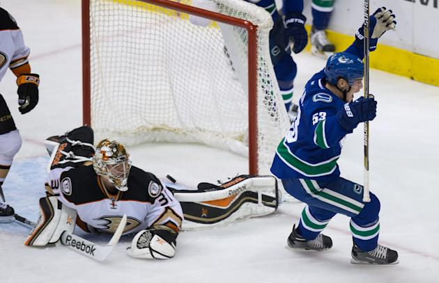 Vancouver Canucks' Bo Horvat, right, celebrates after scoring against Anaheim Ducks goalie Frederik Andersen,during the second period on Nov. 20, 2014. (AP Photo/The Canadian Press, Darryl Dyck)