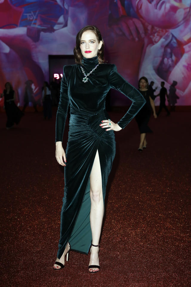 <p>Actress Eva Green donned a velvet emerald-hued dress and red lip for the BVLGARI Dinner and Party on June 28. <em>[Photo: Getty]</em> </p>