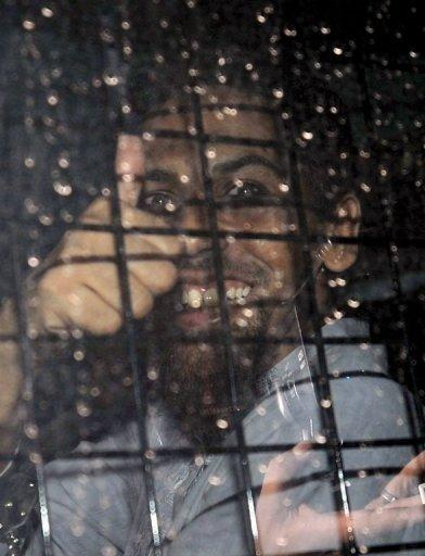 Indonesian terror suspect Umar Patek gives a thumbs-up from a police vehicle after a hearing in Jakarta, on May 3. Patek, 45, is accused of being a central figure in attacks on two nightclubs in the Indonesian resort island of Bali -- which claimed the lives of 88 Australians -- and on churches in Jakarta on Christmas Eve in 2000