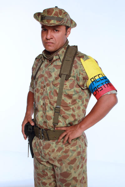 """FILE - In this 2012 promotional file photo provided by RCN Television, actor Julian Roman poses in character as Carlos Castano for the television series """"Tres Caines,"""" or """"Three Cains,"""" an allusion to the Biblical story of Cain slaying his brother Abel, in Bogota, Colombia. The soap opera has stirred unprecedented controversy by dramatizing _ and some say romanticizing _ the career of the Castano brothers, central figures in the creation of the country's murderous far-right militias. (AP Photo/RCN Television, File)"""