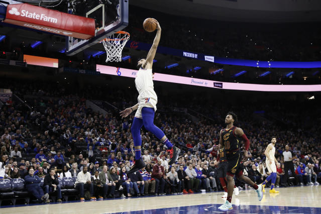Philadelphia 76ers' Ben Simmons goes up for a dunk during the first half of an NBA basketball game against the Cleveland Cavaliers, Saturday, Dec. 7, 2019, in Philadelphia. (AP Photo/Matt Slocum)