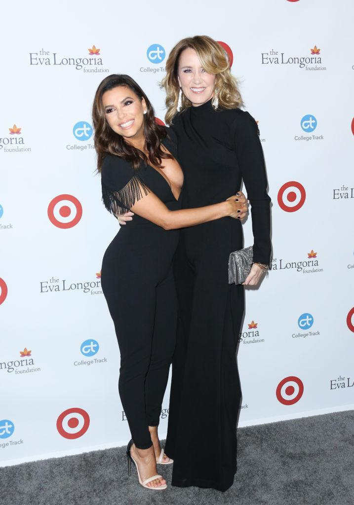"""<p>Huffman reunited with her former <i>Desperate Housewives </i>co-star at the <a rel=""""nofollow noopener"""" href=""""http://www.evalongoriafoundation.org/about"""" target=""""_blank"""" data-ylk=""""slk:Eva Longoria Foundation'"""" class=""""link rapid-noclick-resp"""">Eva Longoria Foundation'</a>s annual dinner in Beverly Hills. The organization helps Latinas empower themselves through education and entrepreneurship. (Photo: FilmMagic) </p>"""