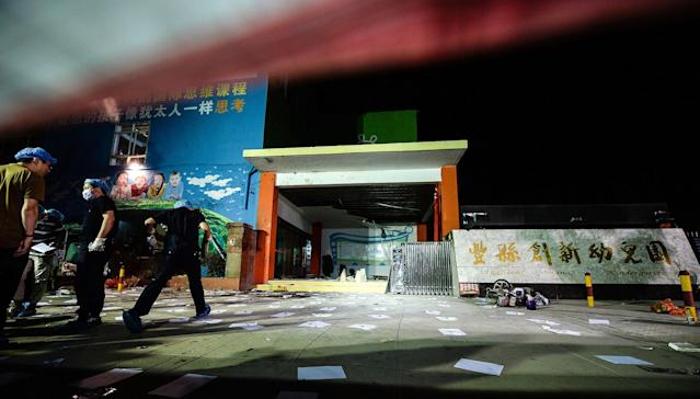 <p>Investigators work early Friday, June 16, 2017, at the scene of an explosion outside a kindergarten in Fengxian County in eastern China's Jiangsu Province. (Photo: Li Xiang/Xinhua via AP) </p>