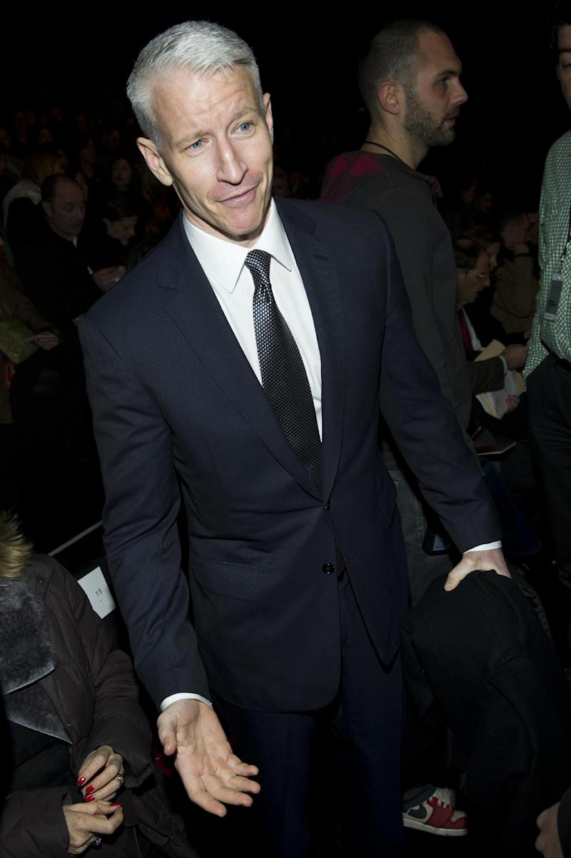 """FILE - In this Feb. 12, 2012 file photo, TV talk show host Anderson Cooper attends the fashion show showing the Fall 2012 collection by this mother, designer Diane von Furstenberg, during Fashion Week in New York. Cooper's daytime talk show """"Anderson"""" will celebrate its 100th episode on Monday, Feb. 20.  (AP Photo/Charles Sykes, file)"""