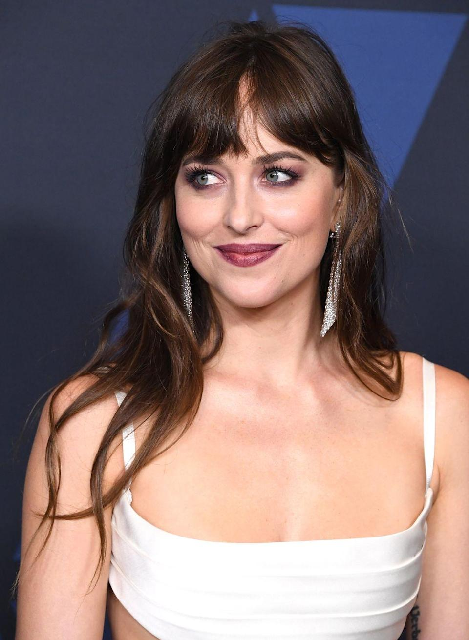 <p>There's a whisper of red in <strong>Dakota Johnson's</strong> brunette strands. The subtle tinge helps her hair catch the light. </p>