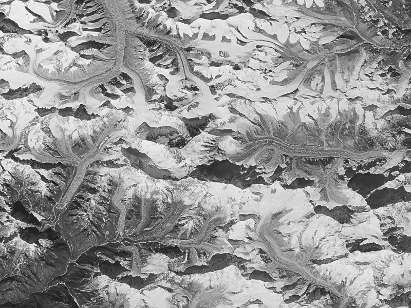 This Jan. 3 1976 photo made by the National Reconnaissance Office shows Mount Everest at center. This and other once-classified Cold War era spy satellite images are showing scientists that glaciers on the Himalayas are now melting about twice as fast as they used to. (National Reconnaissance Office via AP)