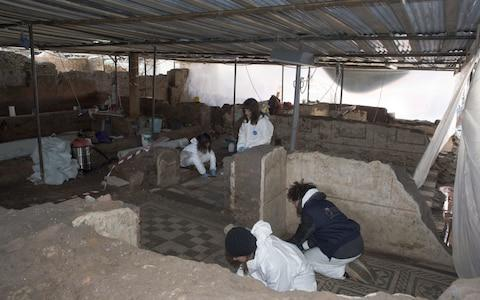 Archaeologists work at the site of the new metro station, Amba Aradam. - Credit: Italian cultural heritage ministry