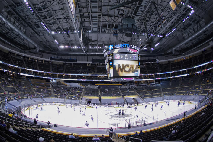 St. Cloud State and Minnesota State players warm up for a semifinal in the NCAA men's Frozen Four hockey tournament in Pittsburgh, Thursday, April 8, 2021,. (AP Photo/Keith Srakocic)