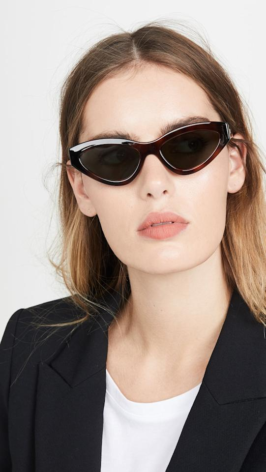 """<p>These <a href=""""https://www.popsugar.com/buy/Le-Specs-Synthcat-Sunglasses-547620?p_name=Le%20Specs%20Synthcat%20Sunglasses&retailer=shopbop.com&pid=547620&price=69&evar1=fab%3Aus&evar9=47190518&evar98=https%3A%2F%2Fwww.popsugar.com%2Ffashion%2Fphoto-gallery%2F47190518%2Fimage%2F47191082%2FLe-Specs-Synthcat-Sunglasses&list1=shopping%2Csunglasses%2Caccessories%2Cfashion%20shopping%2Cbest%20of%202020&prop13=mobile&pdata=1"""" rel=""""nofollow"""" data-shoppable-link=""""1"""" target=""""_blank"""" class=""""ga-track"""" data-ga-category=""""Related"""" data-ga-label=""""https://www.shopbop.com/synthcat-sunglasses-le-specs/vp/v=1/1547218433.htm?folderID=13558&amp;fm=other-viewall&amp;os=false&amp;colorId=1706E&amp;ref=SB_PLP_EP_30"""" data-ga-action=""""In-Line Links"""">Le Specs Synthcat Sunglasses</a> ($69) are futuristic but still go with lots of different outfit options.</p>"""