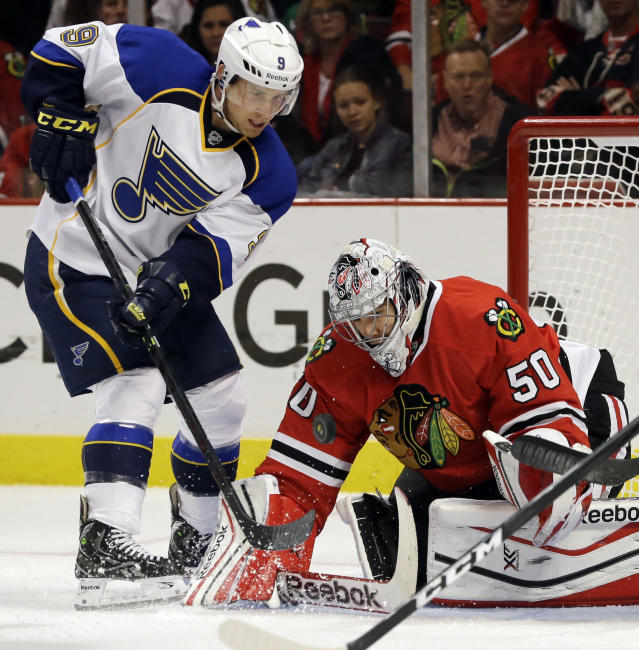 Chicago Blackhawks goalie Corey Crawford (50) blocks a shot by St. Louis Blues' Jaden Schwartz (9) during the first period of an NHL hockey game in Chicago, Thursday, Oct. 17, 2013. (AP Photo/Nam Y. Huh)
