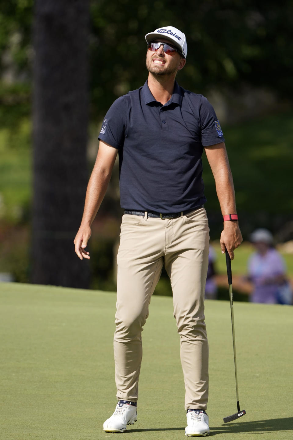 Roger Sloan, of Canada, reacts to his missed birdie putt attempt on the 18th green during the first round of the Wyndham Championship golf tournament at Sedgefield Country Club on Thursday, Aug. 13, 2020, in Greensboro, N.C. (AP Photo/Chris Carlson)