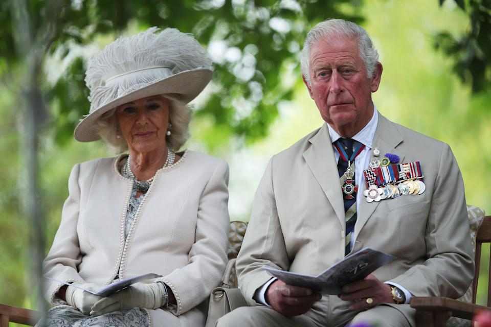 Britain's Prince Charles, Prince of Wales (R) and Britain's Camilla, Duchess of Cornwall (L) attend a national service of remembrance at the National Memorial Arboretum in Alrewas, central England on August 15, 2020, to mark the 75th anniversary of VJ (Victory over Japan) Day. (Photo by MOLLY DARLINGTON / POOL / AFP) (Photo by MOLLY DARLINGTON/POOL/AFP via Getty Images)