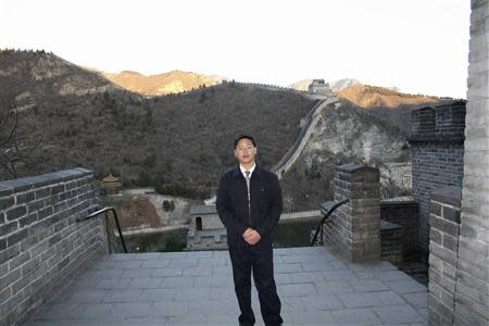 Chinese labour activist Zhang Zhiru poses for pictures at the Great Wall in Beijing, in this handout picture taken in 2008 and provided to Reuters on April 23, 2014. REUTERS/Courtesy of Zhang Zhiru's family/Handout via Reuters