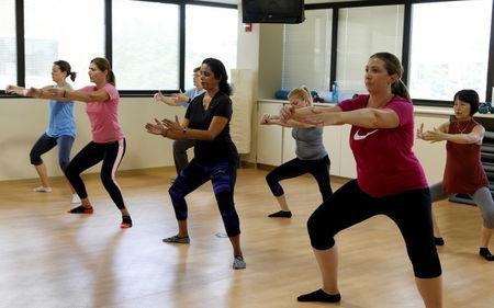 Dr. Anu Puttagunta, endocrinologist (2nd R), participates with hospital staff in a MOVE exercise class at Saint Joseph Mercy hospital in Ypsilanti, Michigan, U.S., August 23, 2017. Picture taken August 23, 2017.   REUTERS/Rebecca Cook