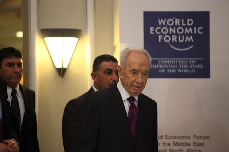 Israeli President, Shimon Peres, right, arrives to give a brief statement at the World Economic Forum, in Southern Shuneh, 34 miles (55 kilometers) southeast of Amman, Jordan, Sunday, May 26, 2013. Peres says it is possible for Israelis and Palestinians to overcome differences and skepticism over peacemaking and that it is time to restart serious negotiations and conclude a peace treaty that has long dogged the two warring sides. (AP Photo/Mohammad Hannon)