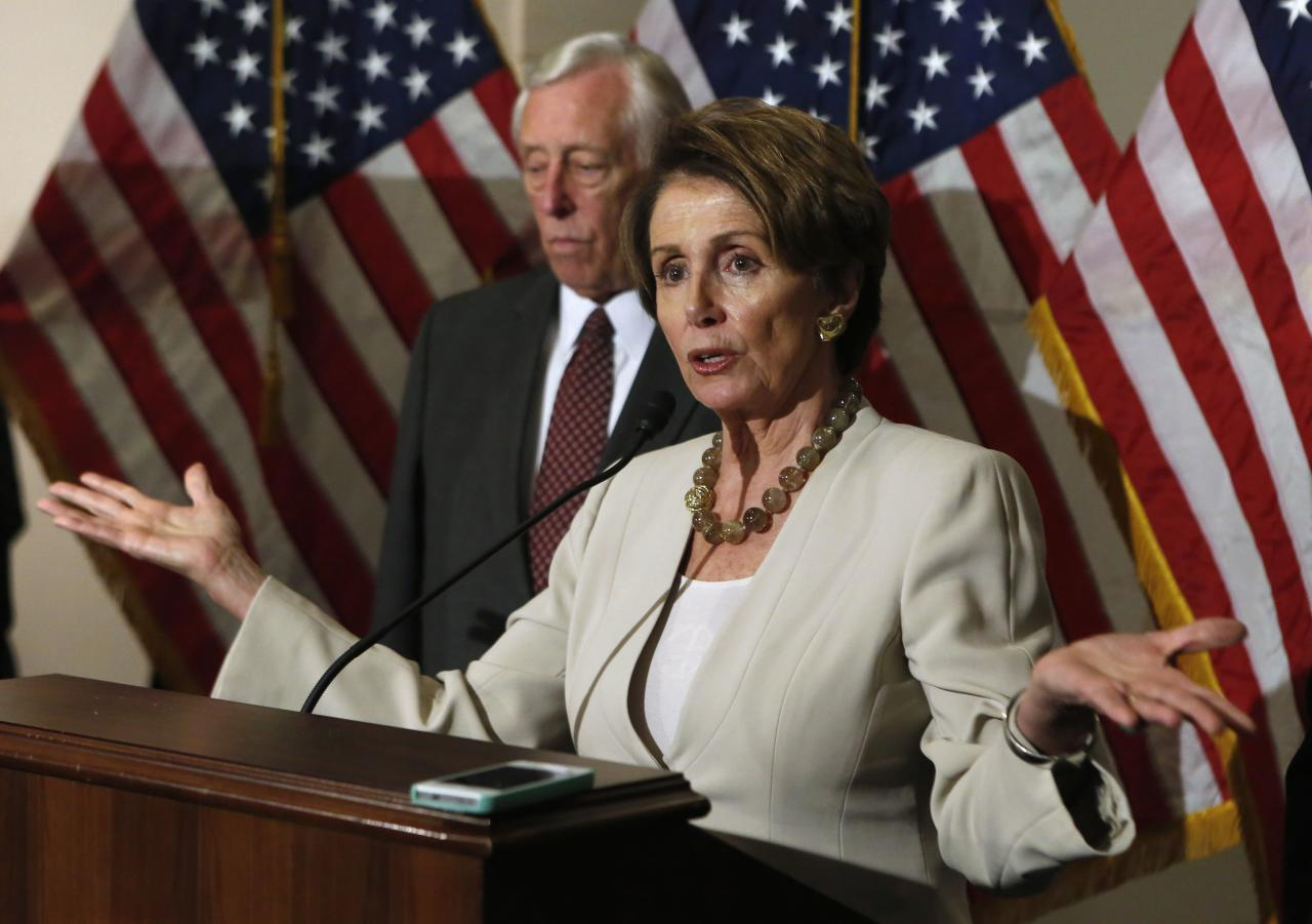 U.S. House Minority Leader Nancy Pelosi (D-CA) talks to the media on Obamacare following a Caucus meeting on Capitol Hill in Washington, November 14, 2013. Democrats in the U.S. House of Representatives are united on the need for improvements to President Barack Obama's health care law and will propose their own legislative changes, Pelosi said on Thursday. REUTERS/Yuri Gripas (UNITED STATES - Tags: POLITICS HEALTH)