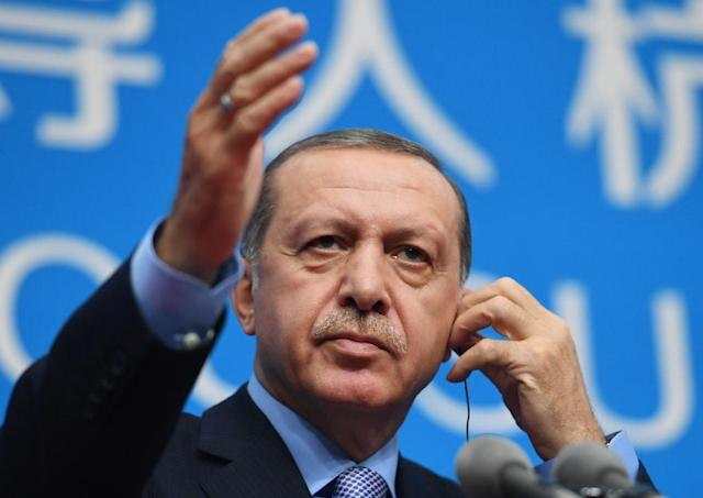 Turkey's President Recep Tayyip Erdogan appeared to suggest that the ratings agency Moody's was corrupt during a televised speech in Ankara (AFP Photo/Greg Baker)
