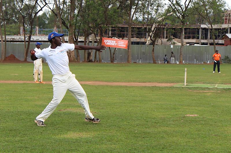 Cricketers during a game on September 7, 2014 at ETO Kicukiro, the former technical school of Kigali where thousands of Rwandans were killed during the 1994 genocide